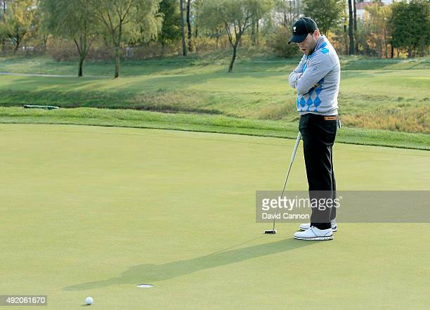 Branden Grace of South Africa and the International Team misses a birdie putt on the seventh hole in his match with Louis Oosthuizen against Patrick...
