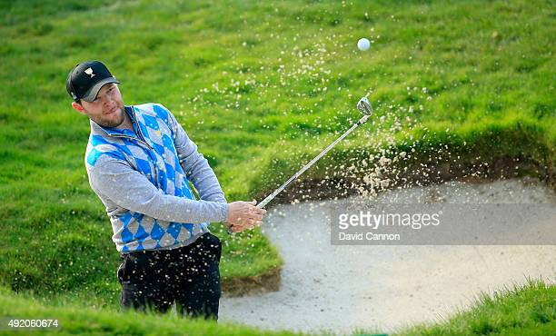 Branden Grace of South Africa and the International Team plays his second shot goes left on the sixth hole in his match with Louis Oosthuizen against...