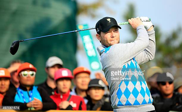 Branden Grace of South Africa and the International Team plays his tee shot on the sixth hole in his match with Louis Oosthuizen against Patrick Reed...