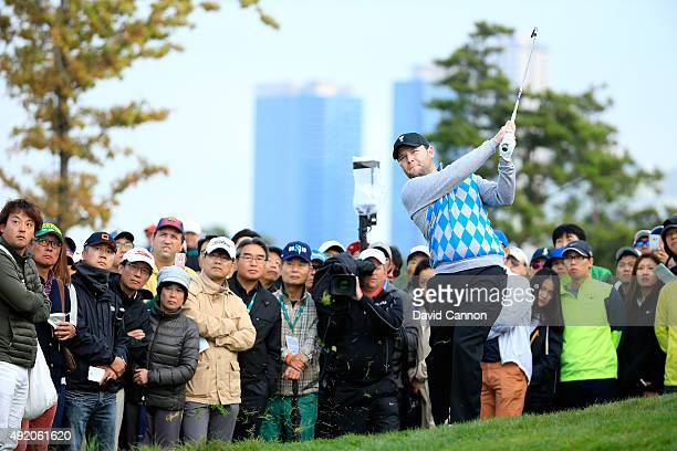 Branden Grace of South Africa and the International Team plays his second shot on the seventh hole in his match with Louis Oosthuizen against Patrick...