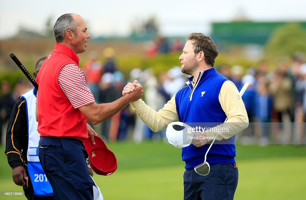 Branden Grace of South Africa and the International team shakes hands with Matt Kuchar of the United States after he had beaten Kuchar by 2&1 during the Sunday singles matches in the 2015 Presidents Cup at the Jack Nicklaus Golf Club Korea on October 11, 2015 in Incheon, South Korea.