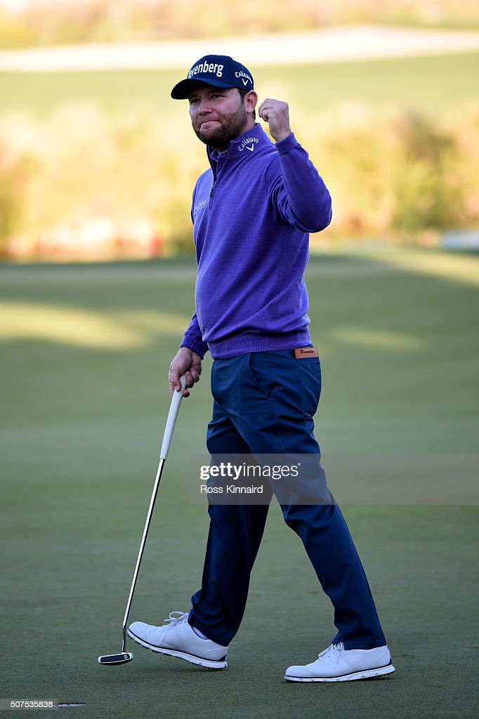 Branden Grace of South Africa celebrate victory on the 18th during the final round of the Commercial Bank Qatar Masters at the Doha Golf Club on January 30, 2016 in Doha, Qatar.