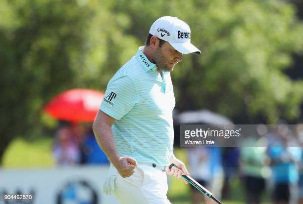 Branden Grace of South Africa celebrates a birdie on the 17th hole during day three of the BMW South African Open Championship at Glendower Golf Club...