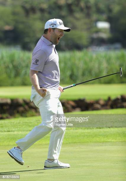 Branden Grace of South Africa celebrates a birdie putt in the 16th hole en route to winning the Nedbank Golf Challenge at Gary Player CC on November...