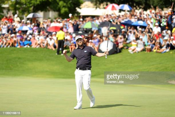 Branden Grace of South Africa celebrates after winning the tournament on the 18th green during Day Four of the South African Open at Randpark Golf...