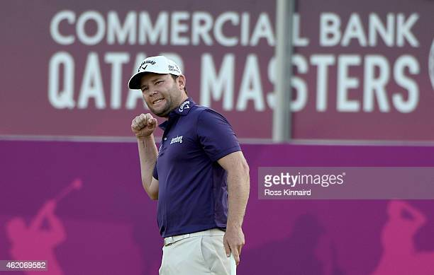 Branden Grace of South Africa celebrates his birdie on the par five 18th hole during the final round of the Commercial Bank Qatar Masters at the Doha...