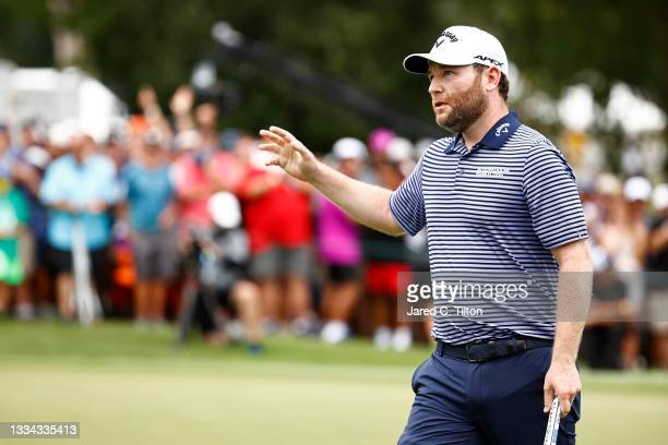 Branden Grace of South Africa celebrates his birdie putt on the 18th green during the final round of the Wyndham Championship at Sedgefield Country...