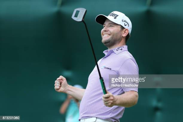 Branden Grace of South Africa celebrates his victory on the 18th green during the final round of the Nedbank Golf Challenge at Gary Player CC on...