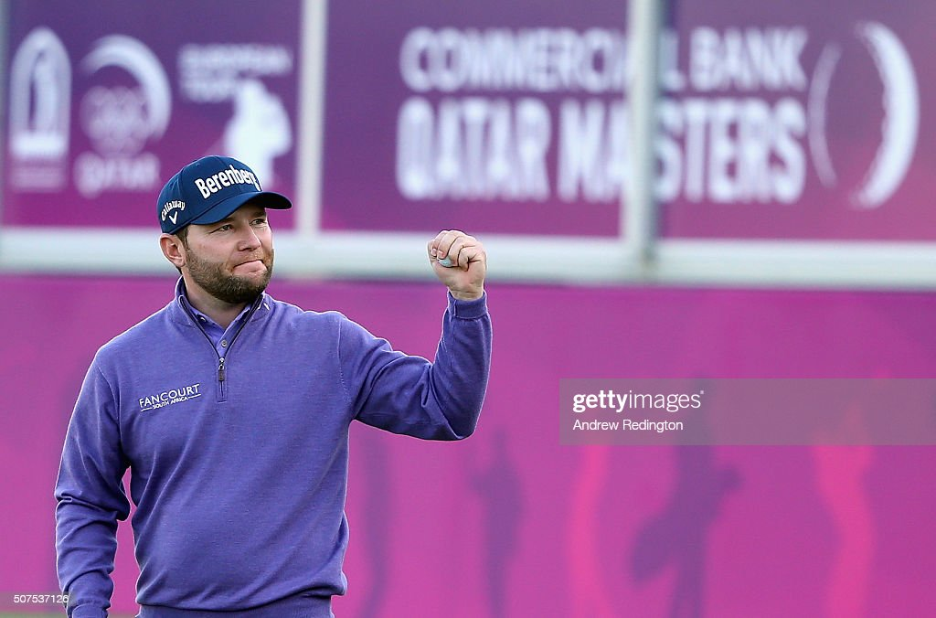Branden Grace of South Africa celebrates on the 18th green after winning the Commercial Bank Qatar Masters at Doha Golf Club on January 30, 2016 in Doha, Qatar.