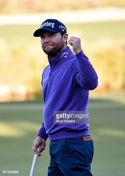 Branden Grace of South Africa celebrates victory on the 18th during the final round of the Commercial Bank Qatar Masters at the Doha Golf Club on...