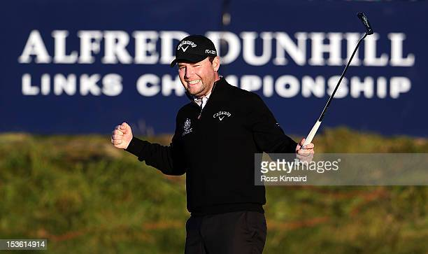 Branden Grace of South Africa celebrates victory on the 18th green after the final round of The Alfred Dunhill Links Championship at The Old Course...