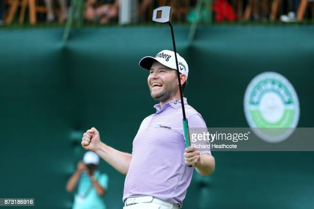 Branden Grace of South Africa celebrates victory on the 18th green during the final round of the Nedbank Golf Challenge at Gary Player CC on November...