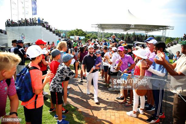 Branden Grace of South Africa celebrates with his child as he walks through the crowds after winning the tournament on the 18th green during Day Four...