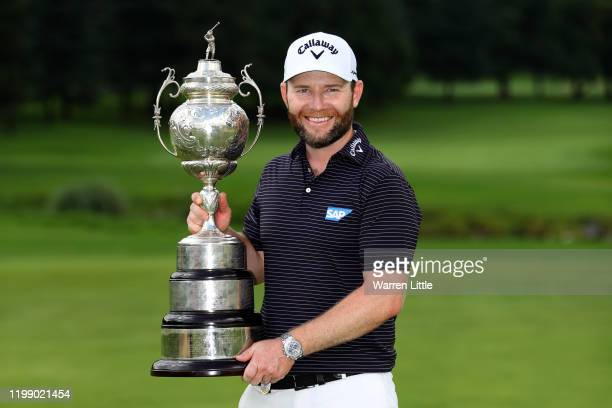 Branden Grace of South Africa celebrates with the trophy after winning the tournament during Day Four of the South African Open at Randpark Golf Club...