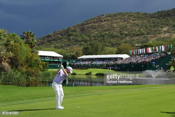 Branden Grace of South Africa hits an approach shot to the 18th green during the final round of the Nedbank Golf Challenge at Gary Player CC on...