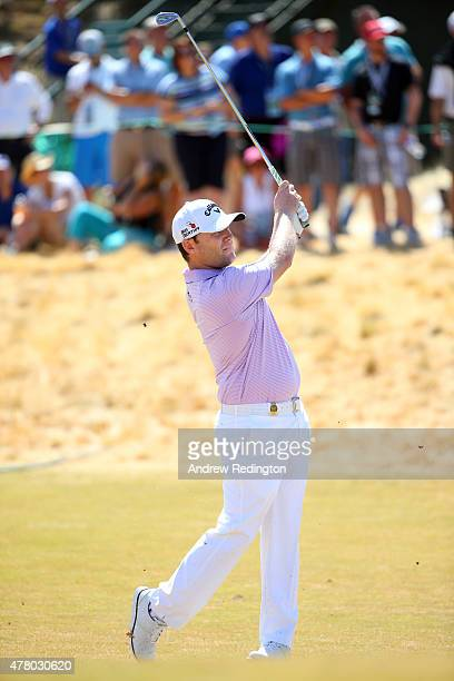 Branden Grace of South Africa hits his second shot on the second hole during the final round of the 115th US Open Championship at Chambers Bay on...