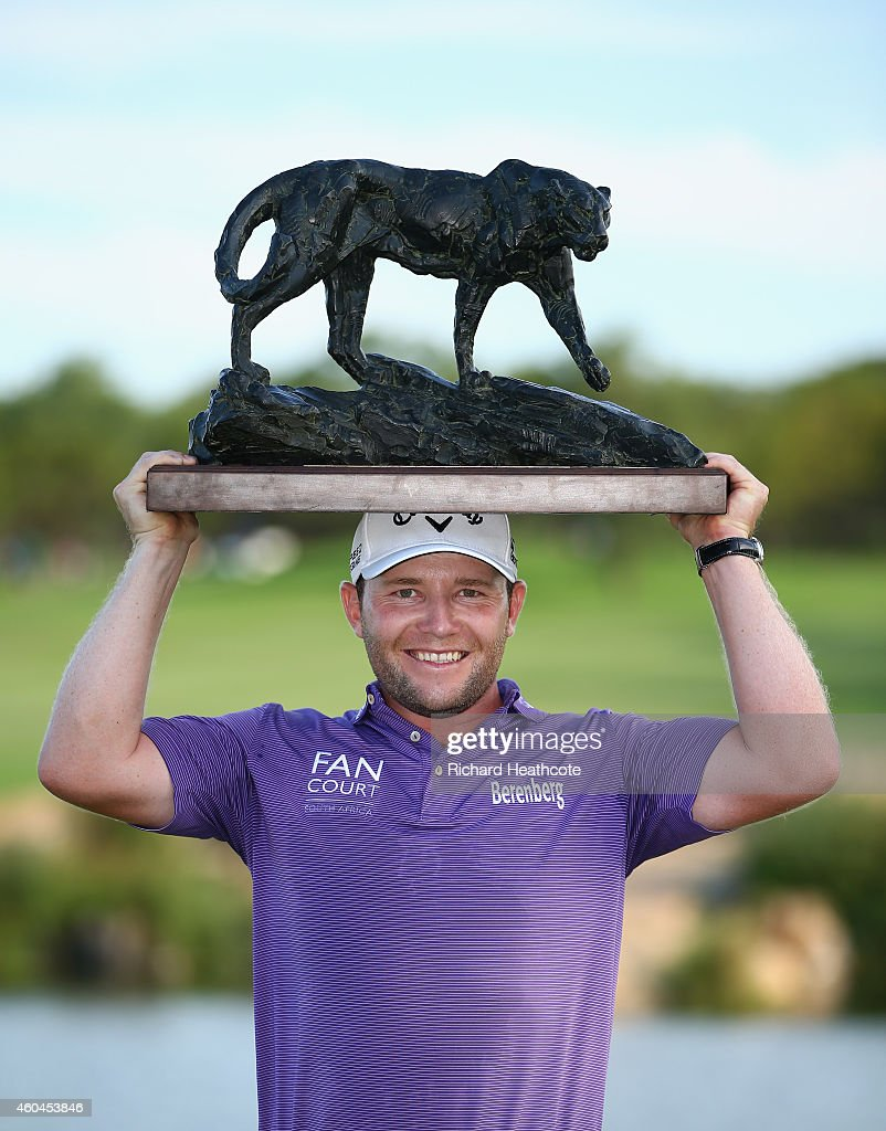 Branden Grace of South Africa holds the trophy after securing victory in the final round of the Alfred Dunhill Championship at Leopard Creek Country Golf Club on December 14, 2014 in Malelane, South Africa.
