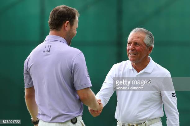 Branden Grace of South Africa is congratulated by Gary Player on the 18th green during the final round of the Nedbank Golf Challenge at Gary Player...