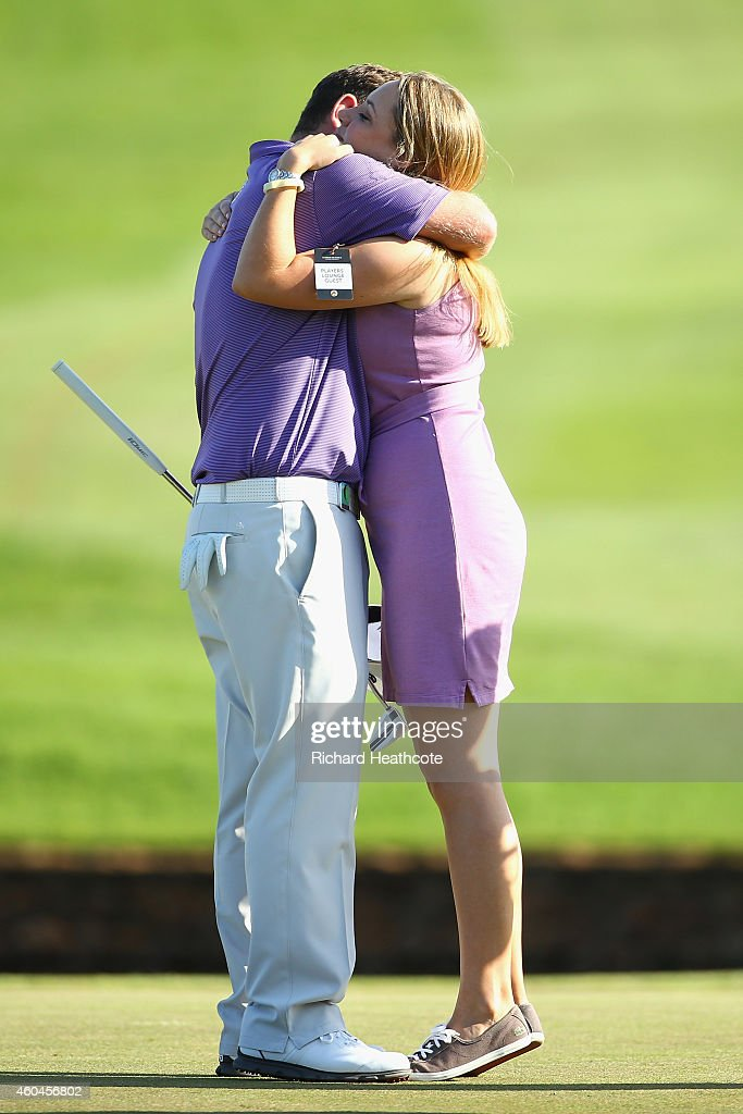 Branden Grace of South Africa is congratulated by his girlfriend Nikie Coetzee after securing victory in the final round of the Alfred Dunhill Championship at Leopard Creek Country Golf Club on December 14, 2014 in Malelane, South Africa.