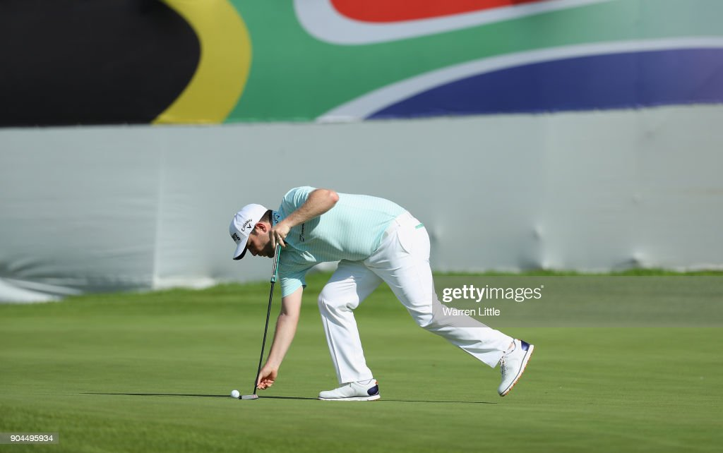 Branden Grace of South Africa lines up a putt on the 18th green during the third round of the BMW South African Open Championship at Glendower Golf Club on January 13, 2018 in Johannesburg, South Africa.