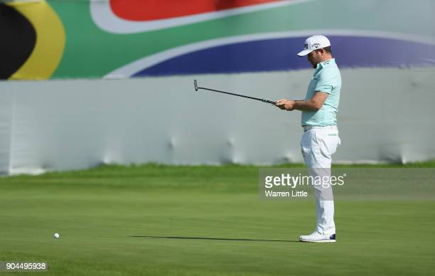 Branden Grace of South Africa lines up a putt on the 18th green during the third round of the BMW South African Open Championship at Glendower Golf...