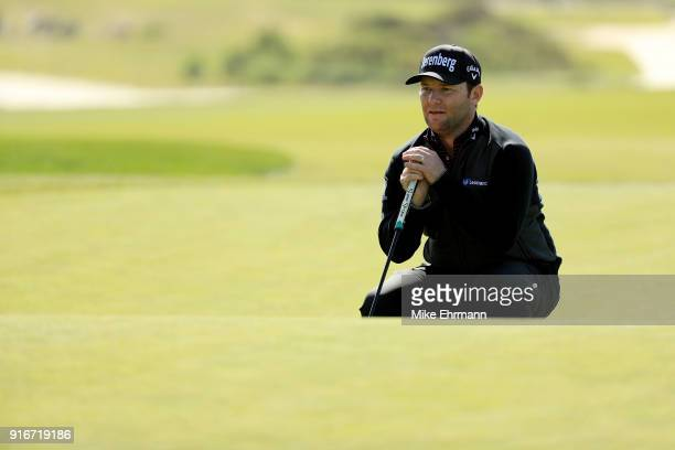 Branden Grace of South Africa lines up a putt on the sixth green during Round Three of the ATT Pebble Beach ProAm at Monterey Peninsula Country Club...