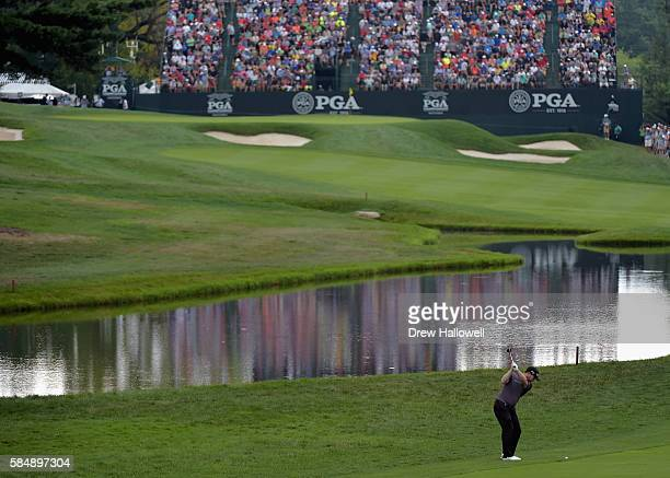 Branden Grace of South Africa plays a shot on the 18th hole after taking a drop during the final round of the 2016 PGA Championship at Baltusrol Golf...
