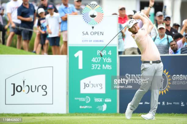 Branden Grace of South Africa plays from the 1st tee during Day 1 of the South African Open at Randpark Golf Club on January 09, 2020 in...