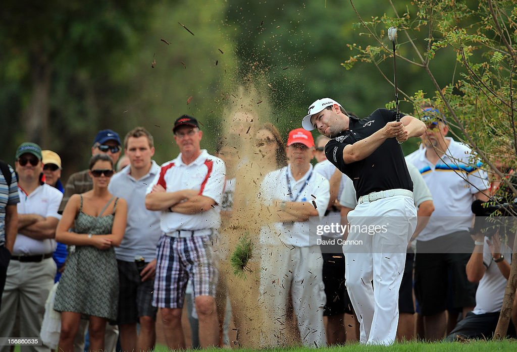 Branden Grace of South Africa plays his second shot at the par 5, 18th hole during the second round of the 2012 DP World Tour Championship on the Earth Course at Jumeirah Golf Estates on November 23, 2012 in Dubai, United Arab Emirates.