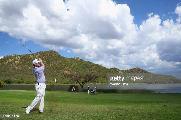 Branden Grace of South Africa plays his second shot into the 17th green during the final round of the Nedbank Golf Challenge at Gary Player CC on...