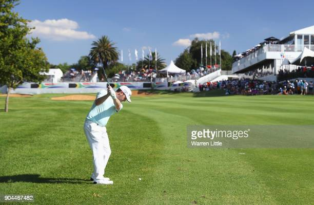 Branden Grace of South Africa plays his second shot on the 18th hole during day three of the BMW South African Open Championship at Glendower Golf...