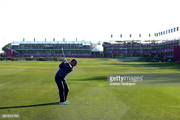 Branden Grace of South Africa plays his second shot on the 18th during the final round of the Commercial Bank Qatar Masters at the Doha Golf Club on...
