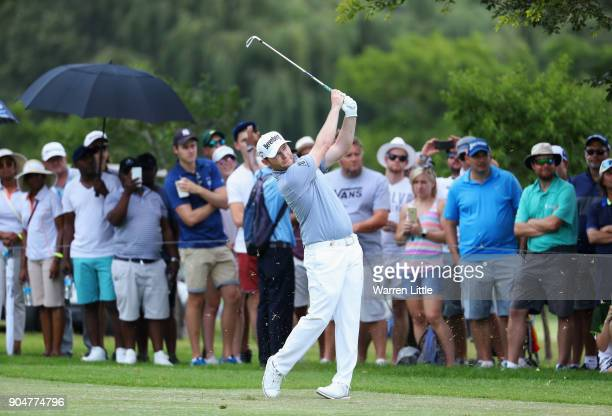 Branden Grace of South Africa plays his second shot on the 5th hole during day four of the BMW South African Open Championship at Glendower Golf Club...