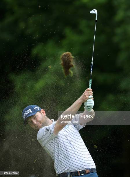 Branden Grace of South Africa plays his second shot on the 6th hole during the final round on day four of the BMW PGA Championship at Wentworth on...