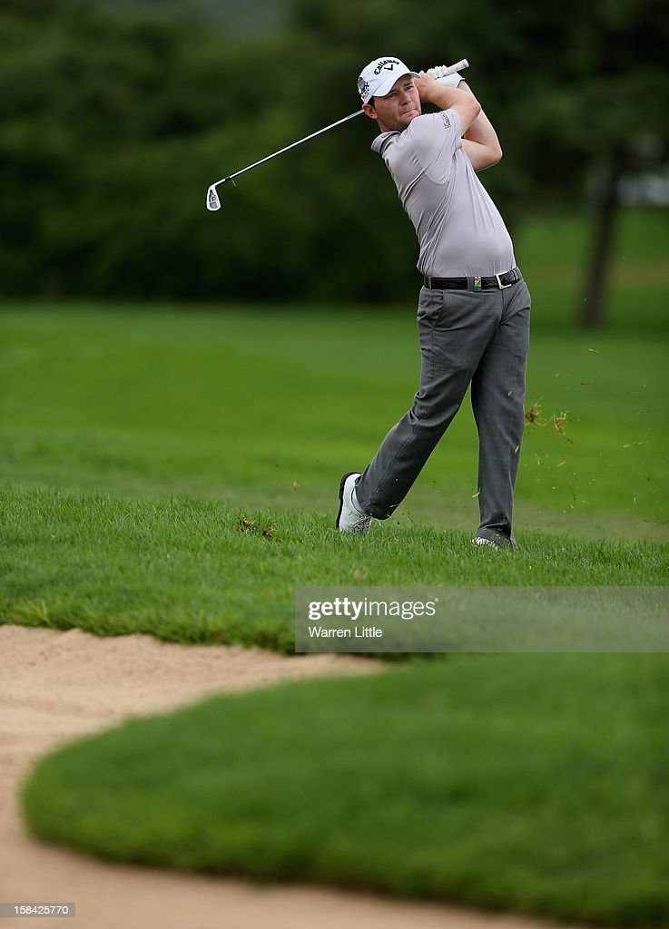 Branden Grace of South Africa plays his seonnd shot on the eighth hole during the final round of the Alfred Dunhill Championship at Leopard Creek Country Golf Club on December 16, 2012 in Malelane, South Africa.