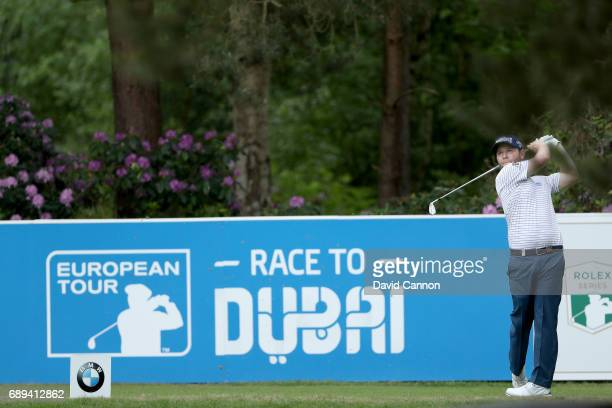Branden Grace of South Africa plays his tee shot at the par 3 10th hole during the final round of the 2017 BMW PGA Championship on the West Course at...