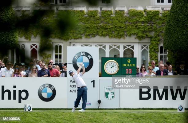 Branden Grace of South Africa plays his tee shot at the par 4 first hole during the final round of the 2017 BMW PGA Championship on the West Course...