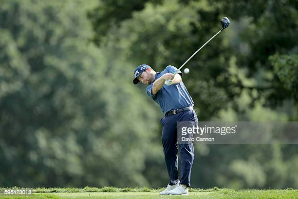 Branden Grace of South Africa plays his tee shot on the fifth hole during the first round of The Barclays in the PGA Tour FedExCup PlayOffs on the...