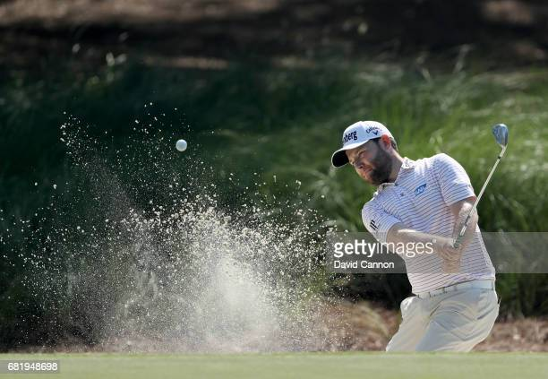 Branden Grace of South Africa plays his third shot on the par 4 14th hole during the first round of THE PLAYERS Championship on the Stadium Course at...