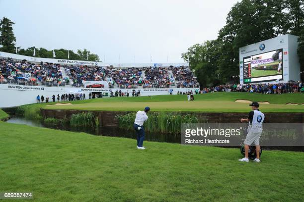 Branden Grace of South Africa plays into the 18th green during day four of the BMW PGA Championship at Wentworth on May 28 2017 in Virginia Water...