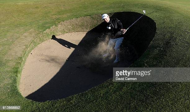 Branden Grace of South Africa plays out from the Road Hole bunker on the 17th during his practise round for the Alfred Dunhill Links Championship at...
