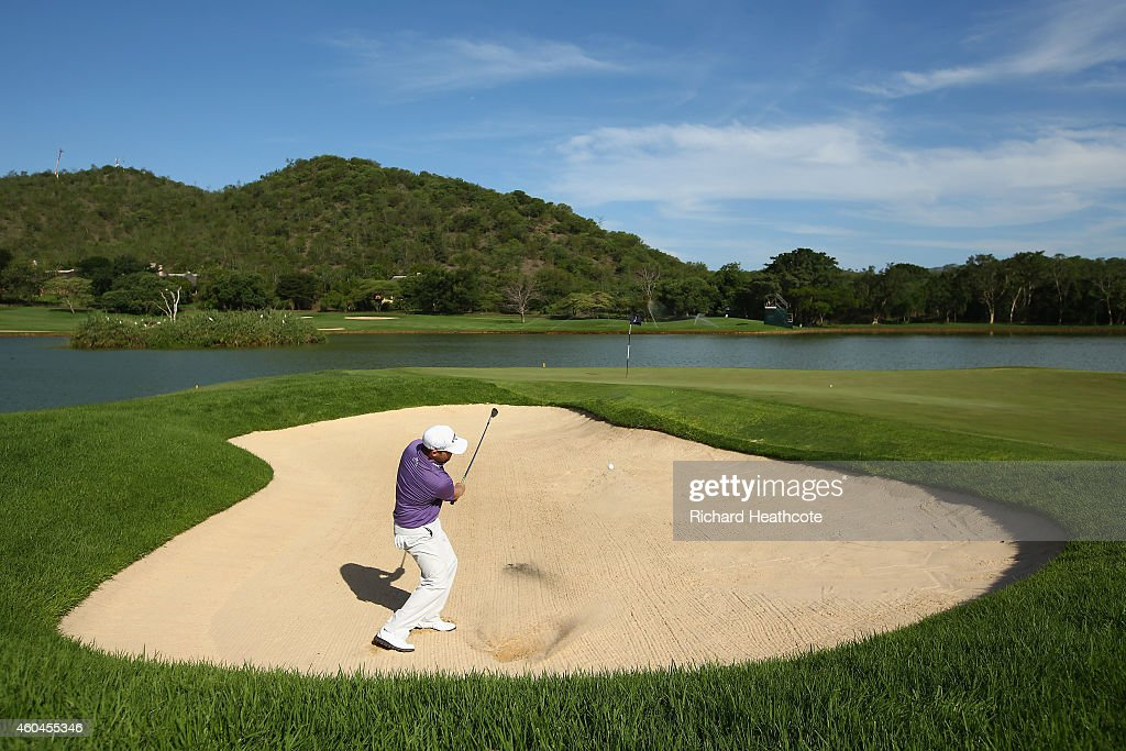 Branden Grace of South Africa plays out of a greenside bunker on the 16th during the final round of the Alfred Dunhill Championship at Leopard Creek Country Golf Club on December 14, 2014 in Malelane, South Africa.