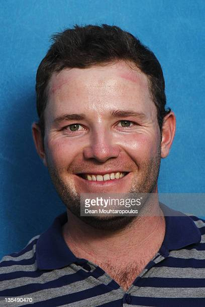 Branden Grace of South Africa poses after Round 1 during the European Tour Qualifying School Final at the PGA Catalunya Resort Golf Course on...