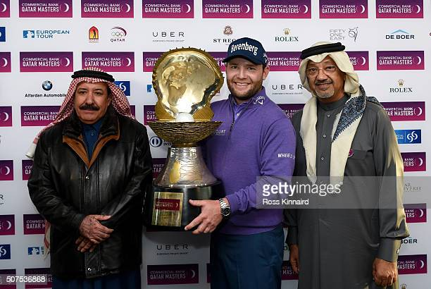 Branden Grace of South Africa poses with the Mother of Pearl trophy next to Hassan Al Nuaimi President Qatar Golf Association and Abdulla Al Raisi...
