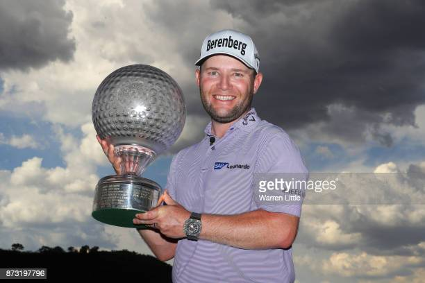 Branden Grace of South Africa poses with the trophy after his victory during the final round of the Nedbank Golf Challenge at Gary Player CC on...