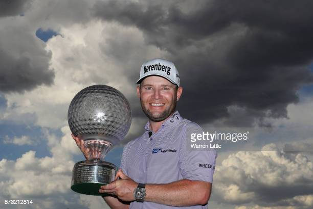 Branden Grace of South Africa poses with the trophy after winning the Nedbank Golf Challenge at Gary Player CC on November 12 2017 in Sun City South...