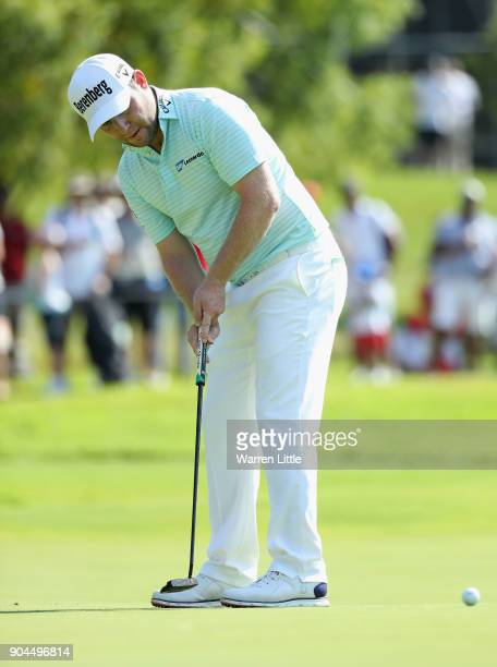 Branden Grace of South Africa putts successfully for bridie on the 17th green during the third round of the BMW South African Open Championship at...