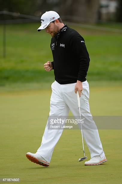 Branden Grace of South Africa reacts after a birdie putt on the third hole of his playoff with John Senden of Australia and Charley Hoffman to win...