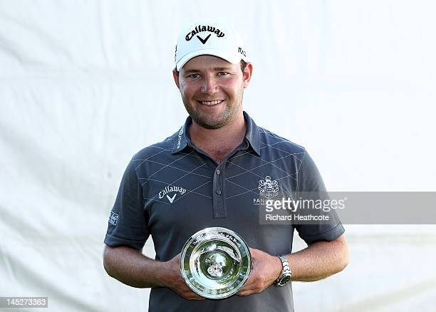 Branden Grace of South Africa receives the European Tour Golfer of the Month Award for January during the second round of the BMW PGA Championship on...