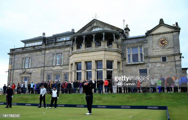 Branden Grace of South Africa tees off from the first tee during a practice round on the Old Course for the 2013 Alfred Dunhill Links Championship on...